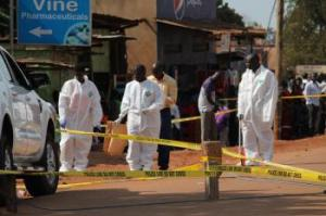 A team of forensic experts search the scene where Joan Kagezi was shot. The double cabin, enclosed off in yellow police tape was where she was shot a little after 7 pm on Monday morning  Photo By: Joan Kagezi