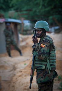 A UPDF soldier passes on information over a walkie-talkie in the Mogadishu sun  Credit: AMISOM Press